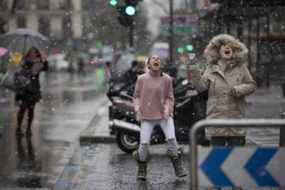 Children play in the snow in Madrid.