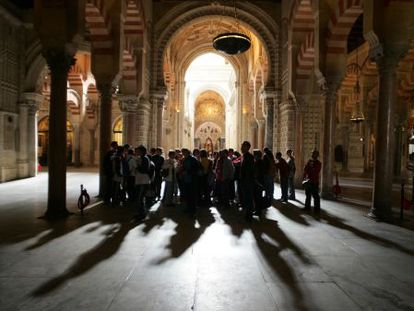 Visitors inside the Mosque-Cathedral of Córdoba.