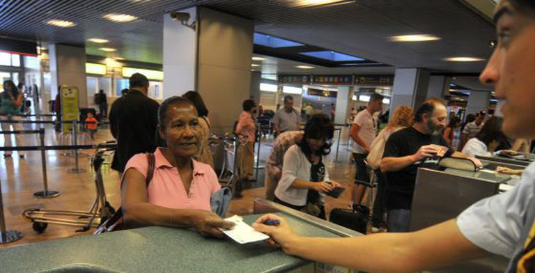 An Ecuadorian immigrant prepares to fly home from Spain after losing her job.