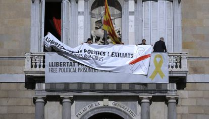 Workers changing the sign on the Catalan government building in March.