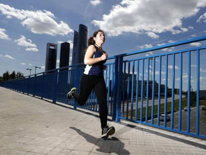 A woman runs in the north of Madrid.