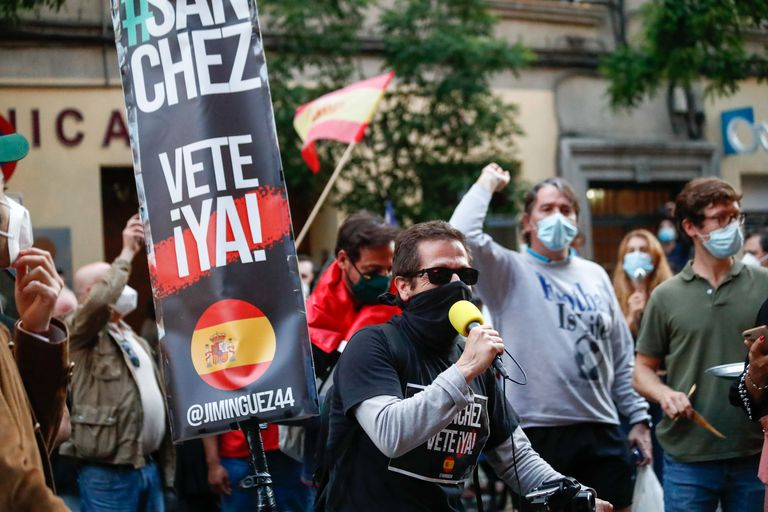 "A sign reading ""Get out Sánchez"" is seen at a protest outside the Spanish Socialist Party headquarters in Madrid on Sunday."