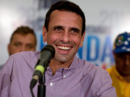 Opposition leader Henrique Capriles appears before the press after Sunday's vote.