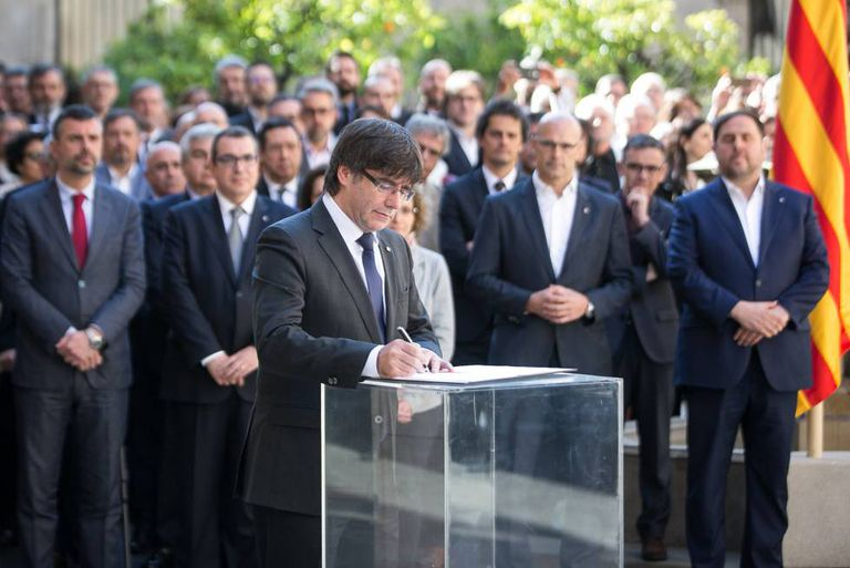 Catalan regional leader Carles Puigdemont signs the manifesto authorizing the independence referendum set for October 1.