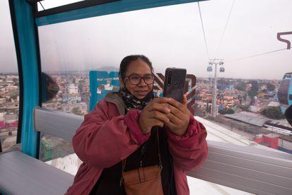 María del Carmen Montero, a resident of Iztapalapa, takes a selfie inside the cable car.