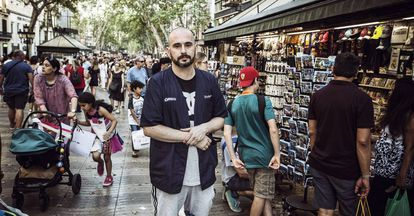 """Pablo Abecasis, 37, by his kiosk on La Rambla. On August 17, he was gravely injured by Younes. He remembers everything: """"The van was coming straight for me. It threw me into the air. I hit the windscreen with my head. I thought I would die."""""""
