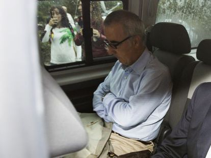 Alfonso Basterra waits during a police search.