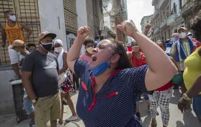A woman shouts pro-government slogans to the protestors in Havana on Sunday.