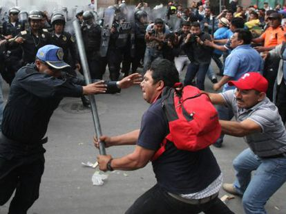 Police clash with protestors during demonstrations on Wednesday.