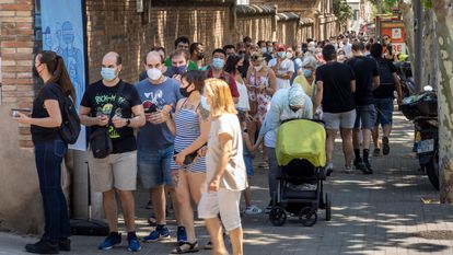 People waiting in line to get vaccinated outside Sant Pau Hospital in Barcelona.