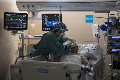 A nurse attends a patient in the ICU of Vall d'Hebron Hospital in Barcelona.