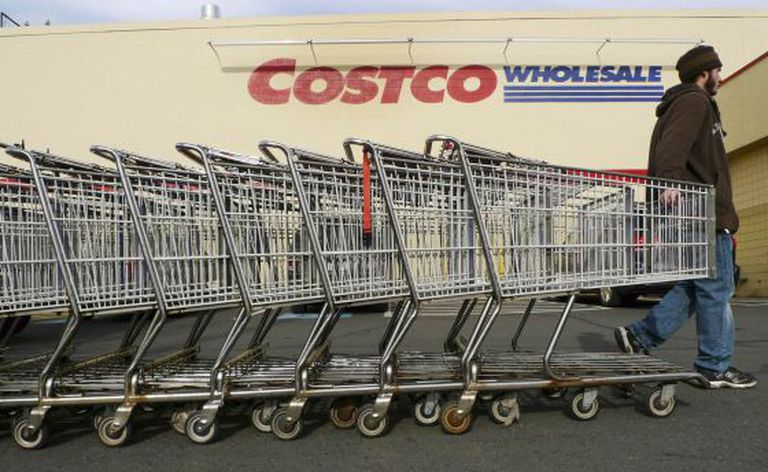 A Costco employee pulls shopping carts at a US branch of the store.