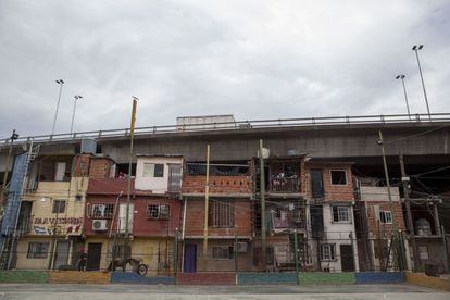 Villa 31 is squeezed underneath a highway.