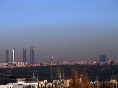 Pollution hanging over the city of Madrid, as seen from the A-6 freeway.