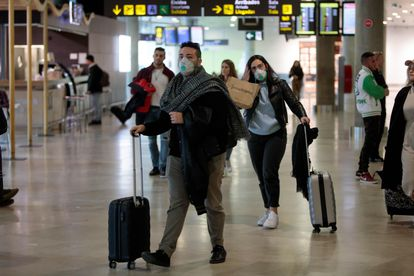 Travelers from Italy arrive in Manises airport in Valencia.