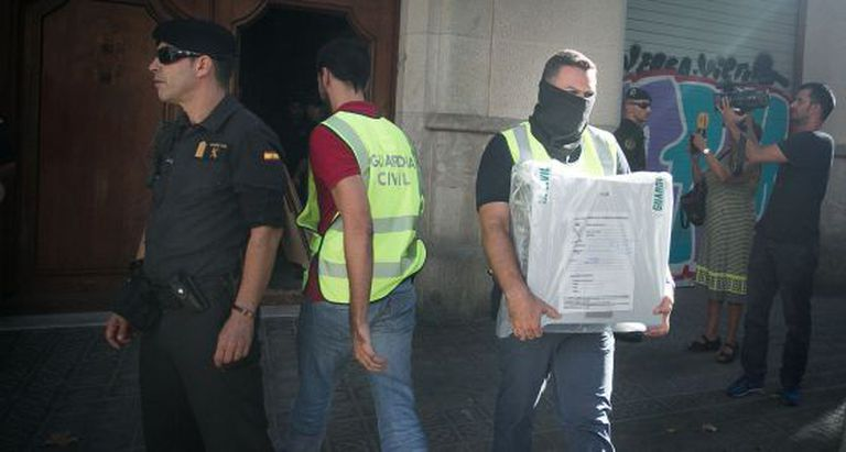 Investigators search the headquarters of the CDC's CatDem foundation in Barcelona in August.