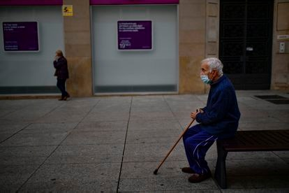 A man sits on a bench wearing a face mask to protect against coronavirus in Pamplona on Saturday.