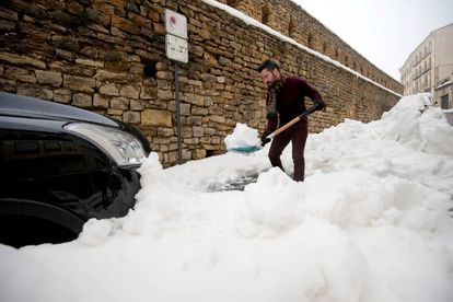 A man shoveling snow in Morella, in the Valencia region.