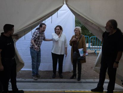 Ada Colau, Pablo Iglesias and Manuela Carmena in an event to establish Podemos as a political party.