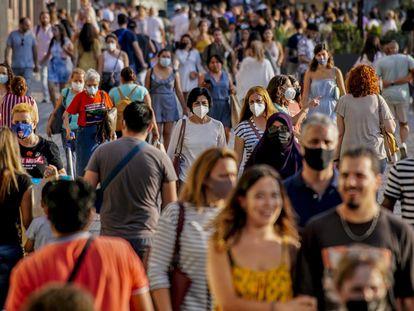 People walk along a street in downtown Barcelona on July 3.