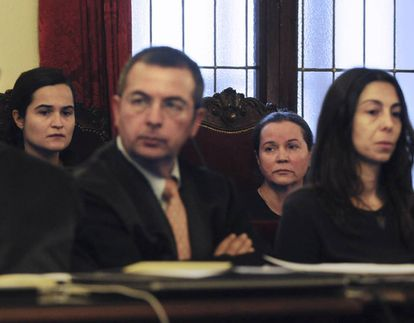 From left to right, Triana Martínez (with defense attorney Fermín Guerrero, Montserrat González and Raquel Gago – the three women convicted of Isabel Carrasco's murder.