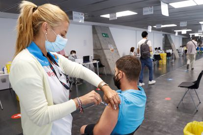 A man getting vaccinated at Madrid's Wizink Center on August 24.