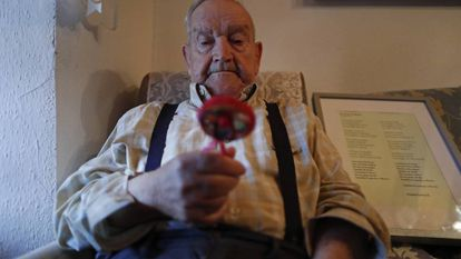 Martín de la Torre holds the rattle his mother took to her execution in 1936.