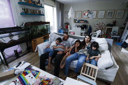 Ana Belen Nieto and her husband Eladio with their three children.