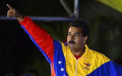 Venezuelan interim President Nicolás Maduro celebrates following the election results in Caracas on April 14, 2013.