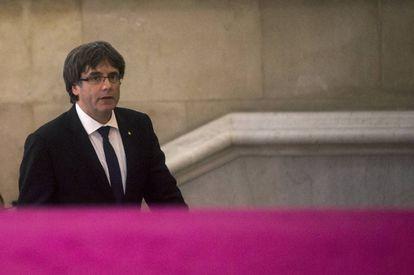 Regional premier Carles Puigdemont arrives in parliament.