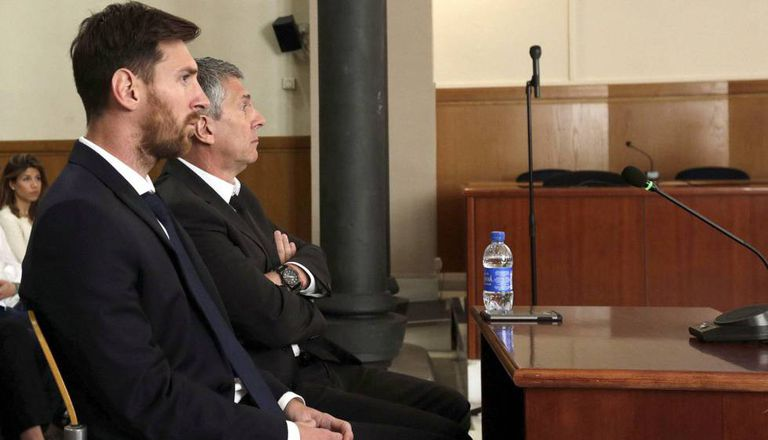 Leo Messi and his father, Jorge Horacio Messi, in court in Barcelona.