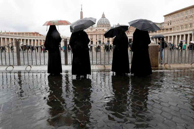 Nuns outside St. Peter's Basilica in the Vatican.