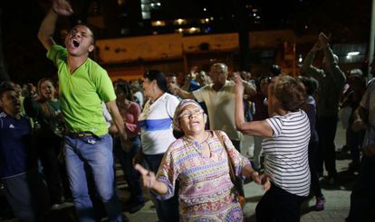 Opposition supporters celebrate the victory in Caracas.