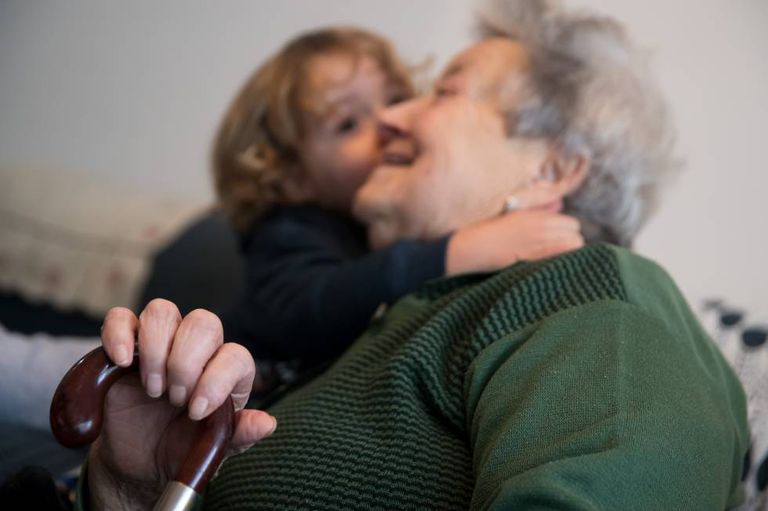 A boy hugs his great-grandmother in the Galician municipality of Ames.