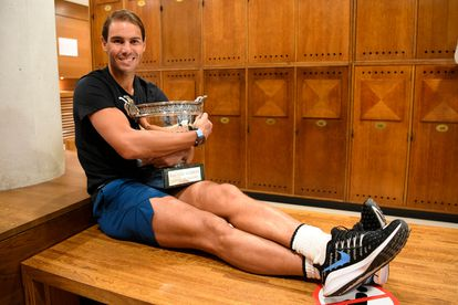 Nadal posing with The Mousquetaires Cup in the locker room.