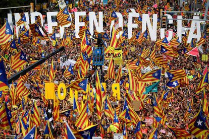 People wave pro-independence flags at the Diada march.