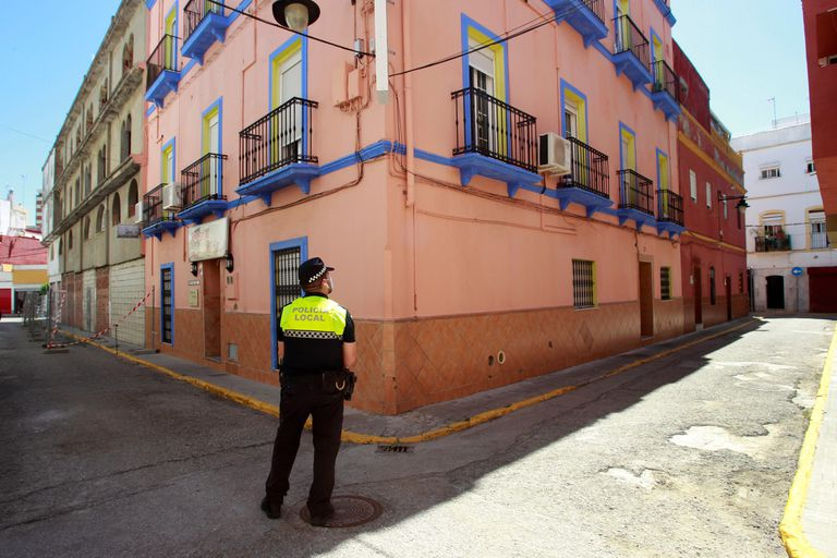 A local police officer outside a hostel in Algeciras, Cádiz, where 17 people are quarantined after a coronavirus outbreak was detected there.