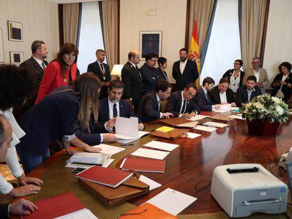 Jailed Catalan separatists complete the paperwork to be sworn in as deputies.