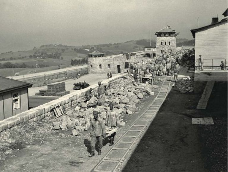 The construction of a wall at Mauthausen at the start of 1941. In the foreground, two Spanish inmates.