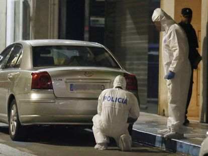 Police inspect the neighborhood where the crime occurred.