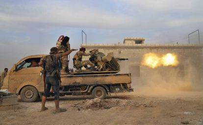Syrian rebels supported by the Turkish army fight the Kurdish-led forces in Manbij, in the north of Syria.