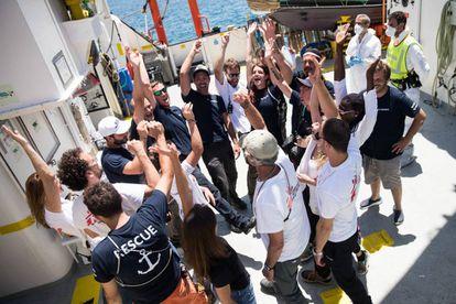 Rescue team members celebrate their arrival in Valencia.