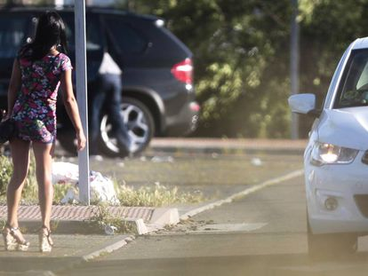 A woman in the Macroni area of Madrid, a known pick-up spot for prostitutes.