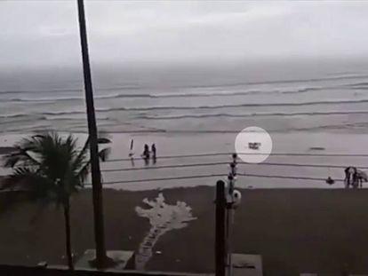 Video: Brazilian woman struck by lightning on beach