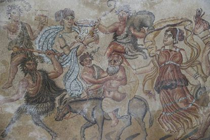 Detail of the mosaic in the living room of the Roman villa showing centaurs, musicians, satyrs and Silenus, represented as the old man on the donkey.