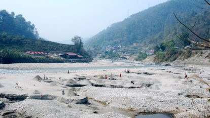 Most of the world's river sand extraction is taking place in developing countries. Pictured, Sunkoshi River near Kathmandu, Nepal.