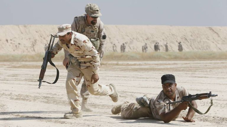 Spanish training instructor working with Iraqi troops.