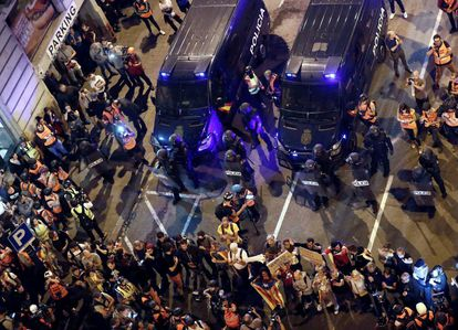 """Urquinaona square was the epicenter of the protests on Saturday. Protesters threw objects at police officers, while others tried to stop them from building barricades. """"This is not the way,"""" they said."""