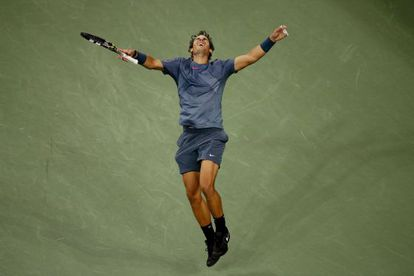 Nadal celebrates his win over Djokovic in the US Open final on Monday night.