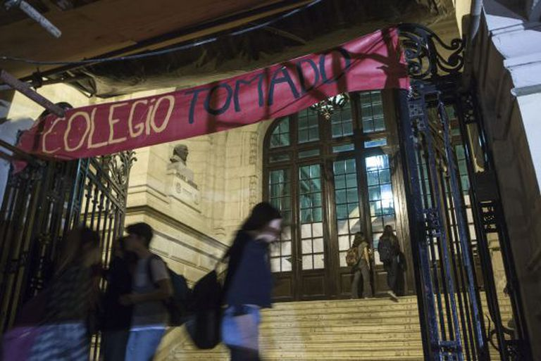 "A banner put up at the National School of Buenos Aires during last week's protest reads ""School Occupied."""